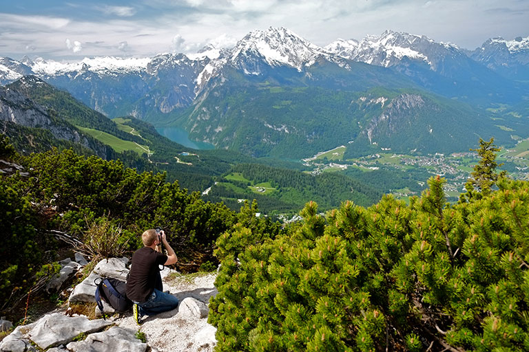 Student taking a photo of the Alps