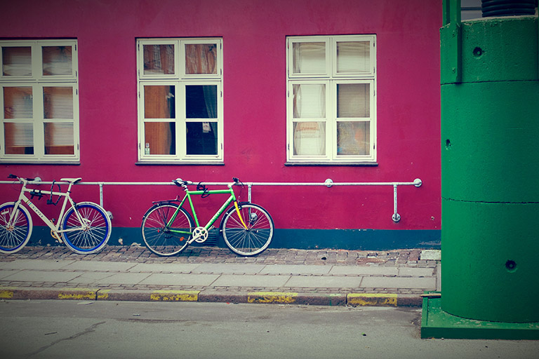 Bikes parked on a pink wall in Denmark