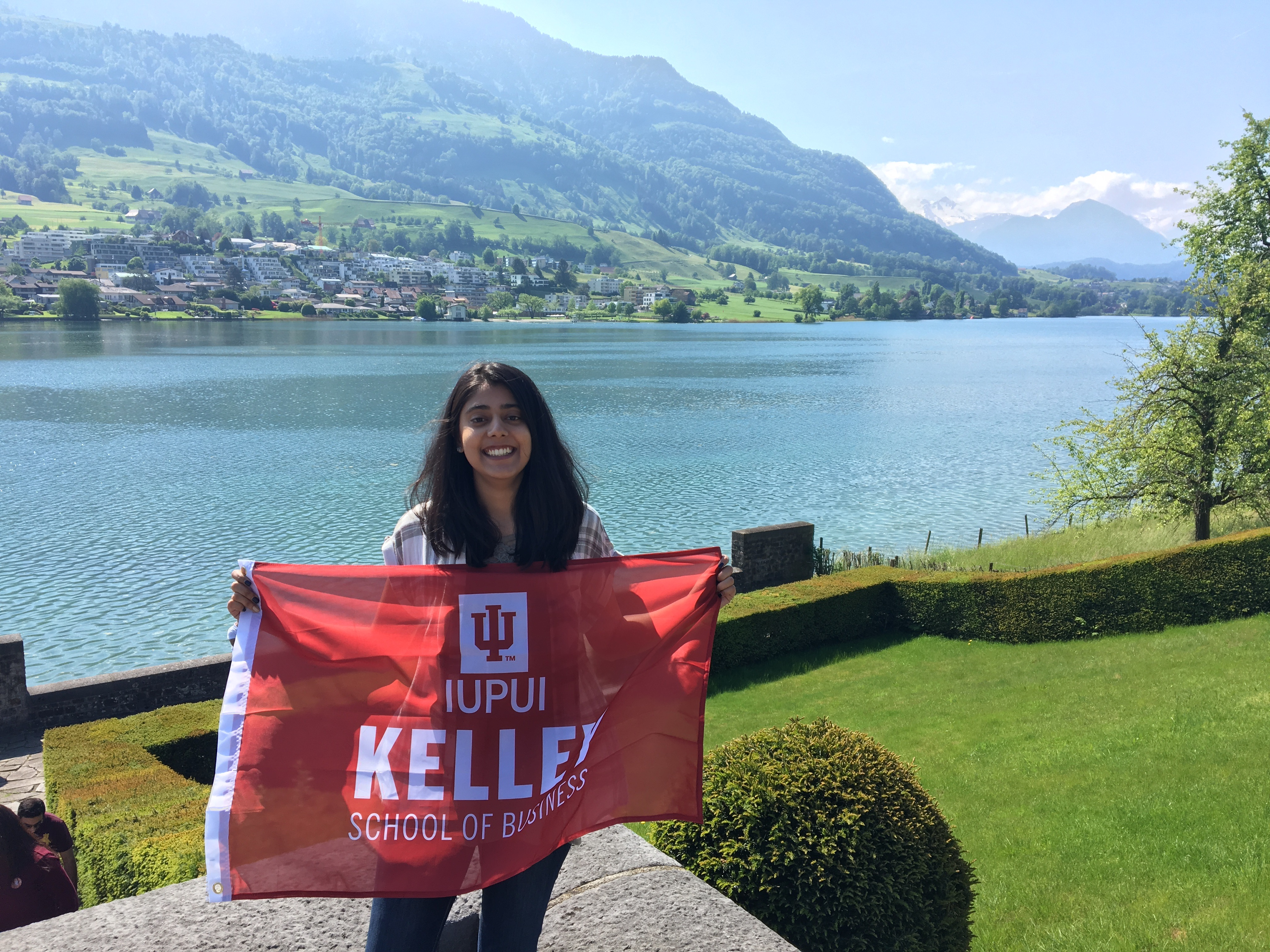 Saira Choudhry with IU Kelley School of Business Flag